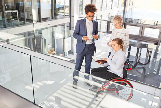 Disabled person in wheelchair at professional workplace